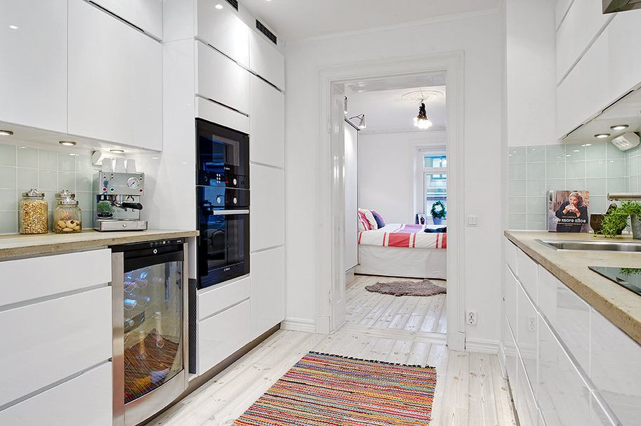 Beautiful scandinavian apartment with cheerful decor and - Cheerful bright kitchen color ideas for sleek interior layout ...