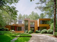 Sheltered by white pines - Kettle Hole House by Robert Young